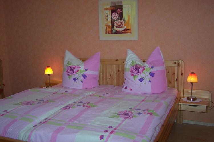 1.Schlafzimmer mit Doppelbett, Kleiderschrank,und Sitzecke