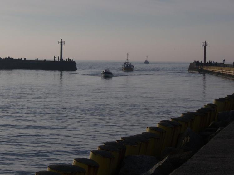 Darlowo lädt zum Spaziergang bis an die Hafenspitze ein. Die Mole ist beidseitig erreichbar.