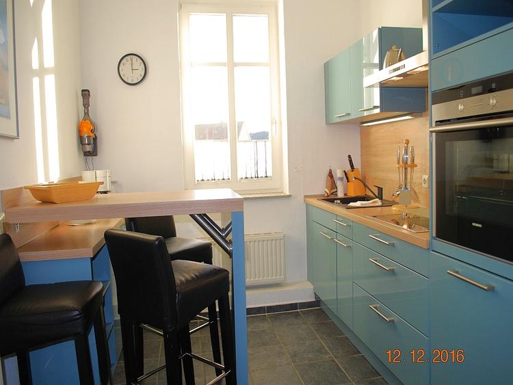Blick in die Küche mit eigenem Essplatz