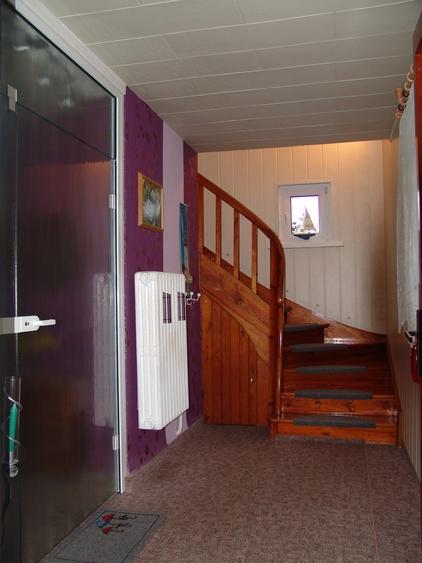Der Eingangsbereich mit Blick auf den Treppenaufgang zu Ihrer Ferienwohnung.