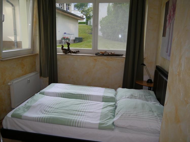 Veranda mit Doppelbett
