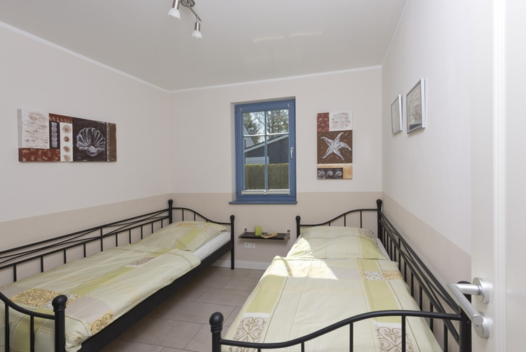 Zimmer mit zwei Einzelbetten