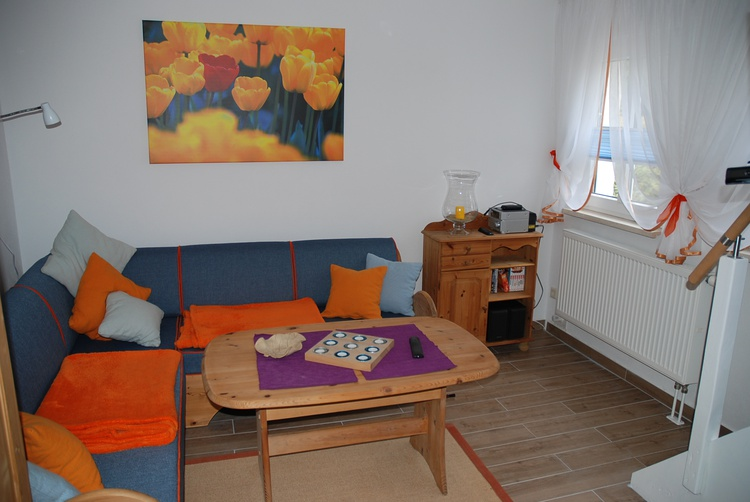 gemütliches Wohnzimmer mit Fußbodenheizung