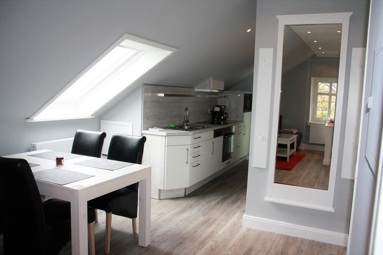 Die modern ausgestattete Küche mit dem Essplatz